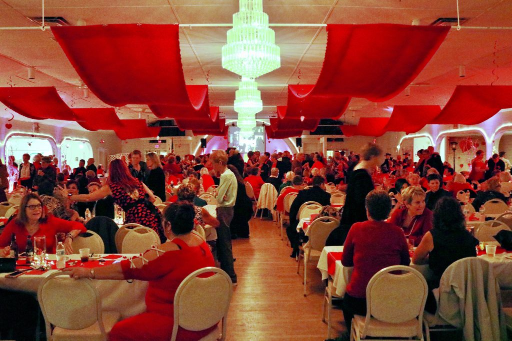 photo of all the tables and women at dance